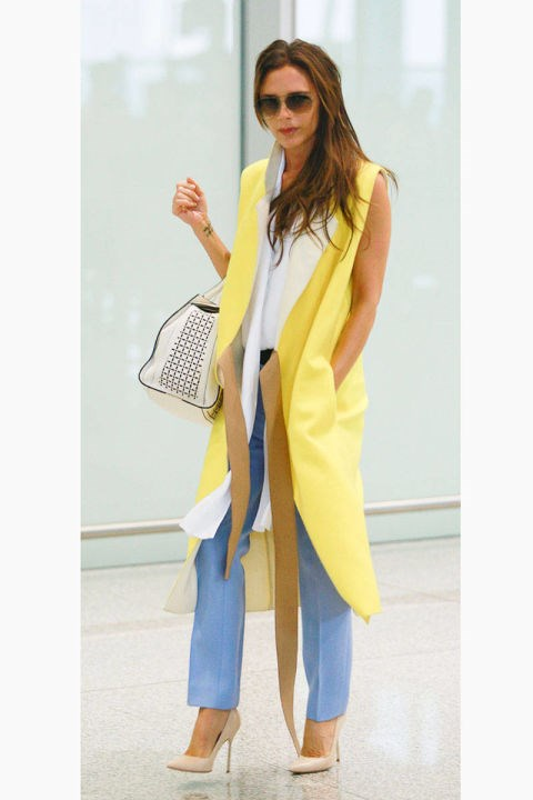 <strong>VICTORIA BECKHAM</strong> <BR> The Queen of Posh airport style lives up to her title in a cheery sleeveless coat, jeans, and sky-high heels, of course.