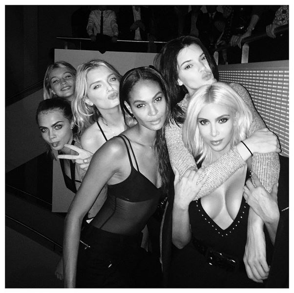 """<strong>Model moment</strong> <BR> <BR> Kim couldn't decide which model to be snapped with, so decided to pose with five of them two weeks ago. """"Not insecure at all standing next to these supermodels,"""" she said."""
