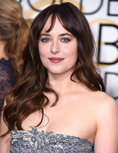 Part wispy bangs in the middle of your forehead, like Dakota Johnson