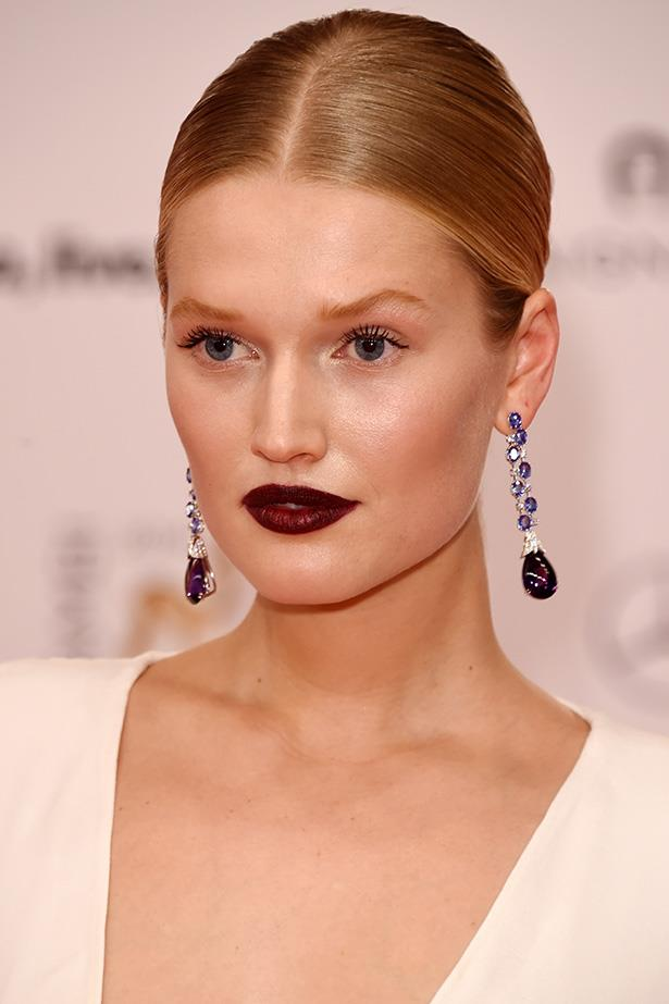 German model Toni Garrn shows that while you can't always pair your make-up with a plain white ensemble, you can optimise statement accents and accessories as a base to match your make-up to. This deep plum look is a killer.