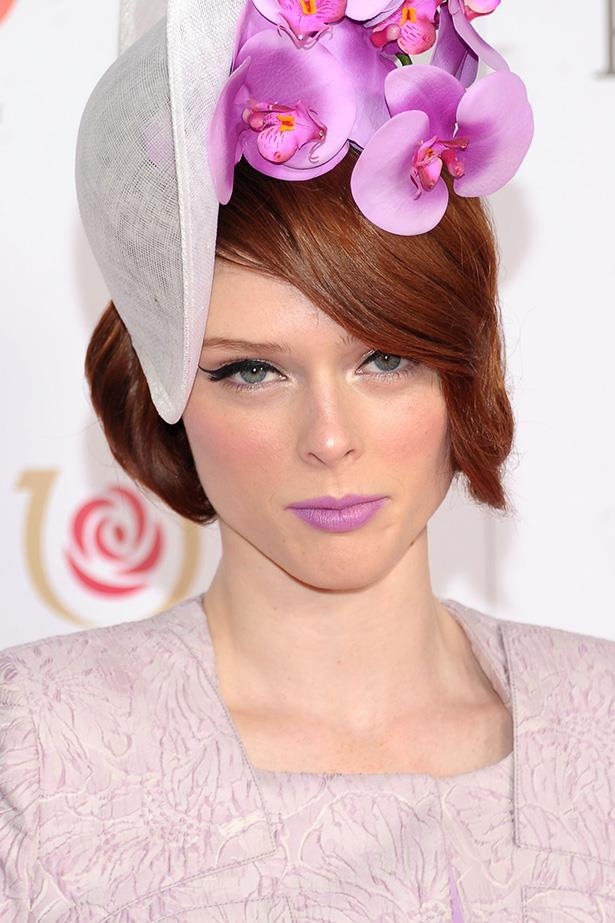 Supermodel Coco Rocha continues to be the manic pixie dream girl of fashion with this eccentric yet demure look. Okay, she's at the races, but we'd still love to give the lilac lip a go any day of the week.