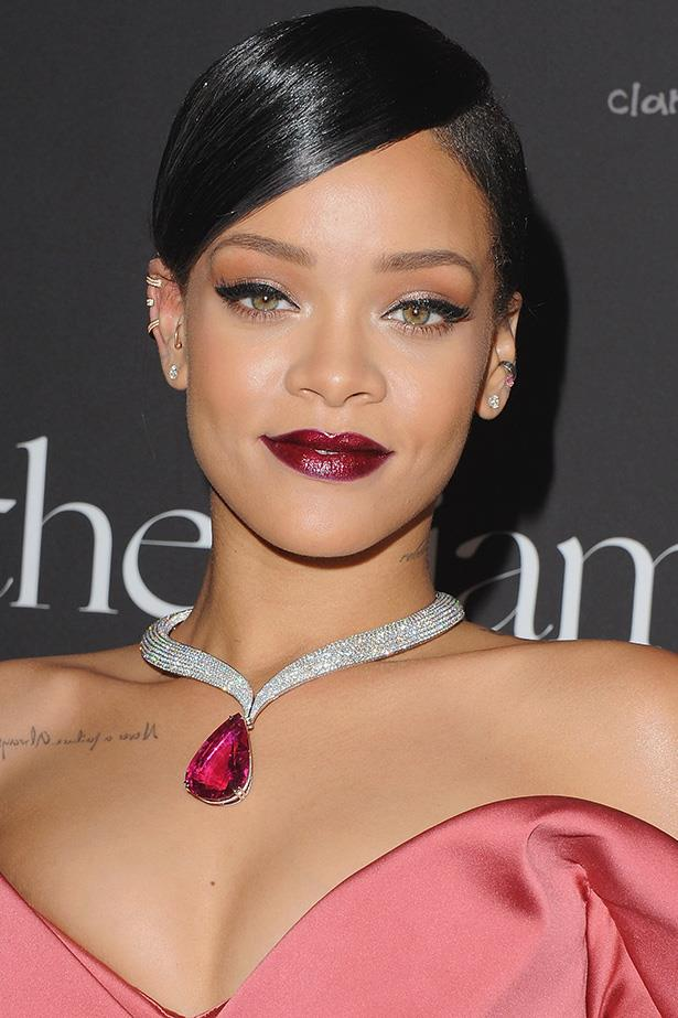 Rihanna's make-up artist gorgeously carries the satin finish of her gown and the glisten of her diamond to her lips.