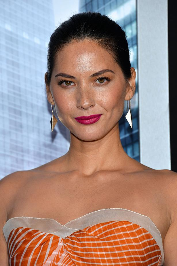 While Olivia Munn's makeup isn't an exact match of her dress, the coral hues in her bronzer are harmonious with her tangerine outfit and the lip brings its own complementing edge.