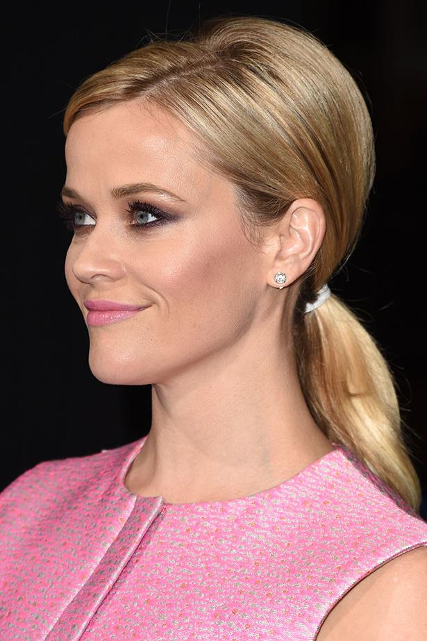 Reese Witherspoon is giving us serious Elle Woods vibes with this pastel pink beauty dream.