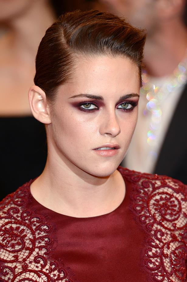 Kristen Stewart picks up where she left off in the <em>Twilight</em> series with this vampy look of deep marsala.