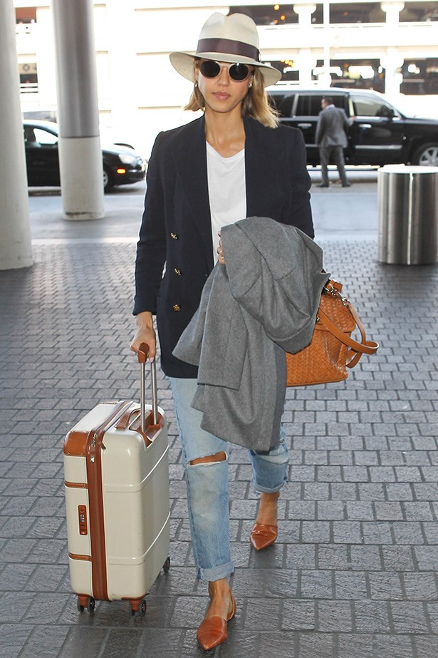 Jessica Alba is resort ready with the matching tan components of her outfit. The nautical blazer and Florida-style fedora also provide unique masculine nuances.