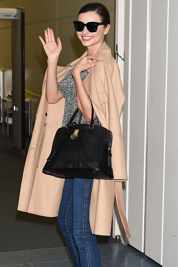 Miranda Kerr presents your ultimate airport staples: slick shades and a killer designer bag.