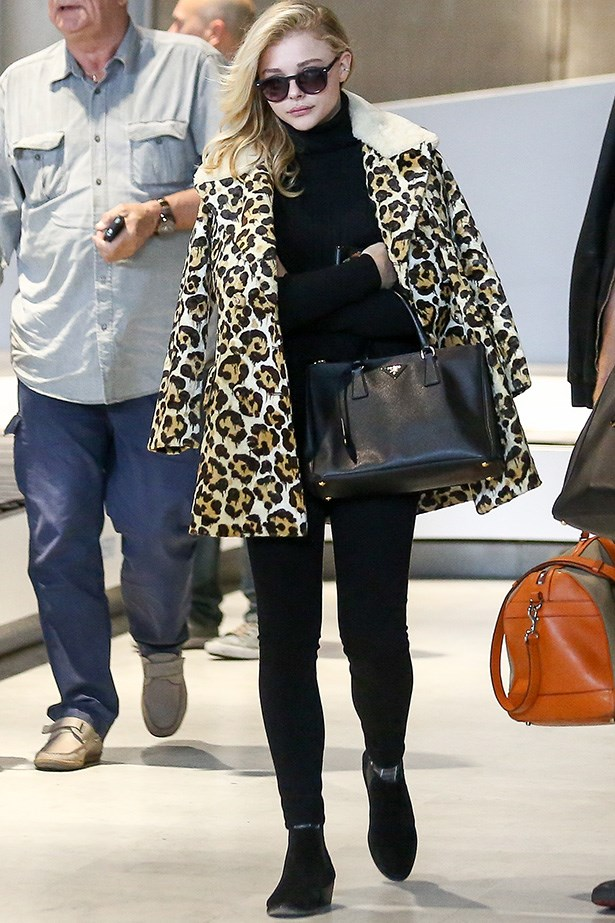 Chloe Grace Moretz is sophisticated in this wintery black ensemble and a cheetah print coat, ensuring those lengthy plane rides never get chilly.