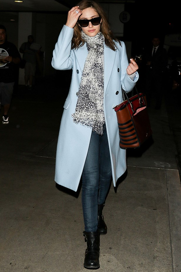 Actress Emmy Rossum goes for the interesting combination of biker boots and a pastel coat, and we're loving it.