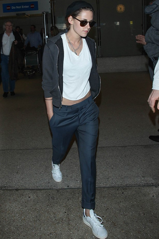Kristen Stewart gets in tune with her tomboy roots and is every bit casual cool at the airport.