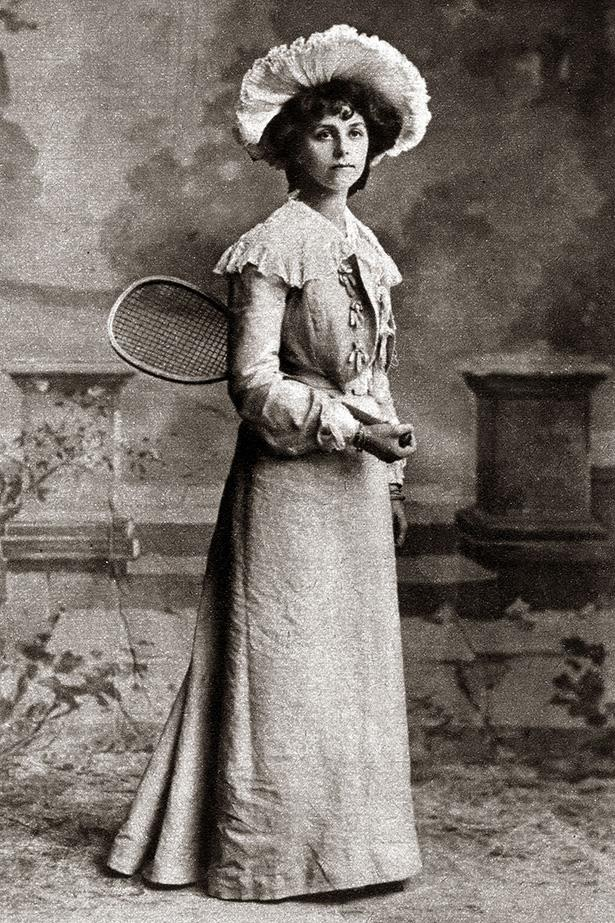 <strong>1895</strong> <br>If you ever saw the struggle that was Beyonce walking up the stairs in a fishtail gown at the Met Gala, you'd recognise the pain in wearing a dress that doesn't suit the proposed physical activity. <br><br>Here we see a woman dressed for a day of tennis, a few years before the turn of the 20th century. Such looks were customary for women as tennis matches were quite the social affair. Full 'n' fancy hats were thus expected to be worn.