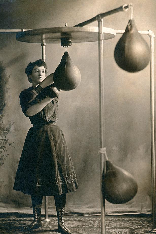 <strong>1890</strong> <br>In the 1800s when you broke a sweat, you damn well broke a sweat. Especially as a woman. <br><br>We love those boxer lace-ups (which are surprisingly chic and reminiscent of those Hermes sandals Kim K loves) but the cinched waist and heavy material of the dress plus the pinned 'do has got to make workouts a true feat of human endurance. But in an unnecessary, wish-my-outfit-was-better sort of way.