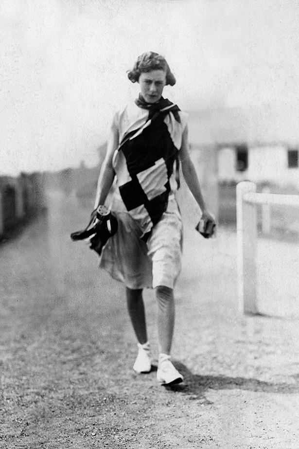 <strong>1928</strong> <br>Fast-forward to the 1920s, when women's fitness wear becomes slightly more lax (thank goodness!). Here's a Parisian golf-fashion look. <br><br>We love the graphic patterns to the frock, the draping and the chic, shapeless cut. Plus the higher hem and lighter material has GOT to have made it easier for women of the day to get active.