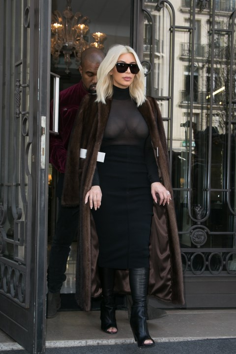 <strong>MARCH 11, 2015</strong> <BR> In a Givenchy coat and boots, Wolford turtleneck, and Proenza Schouler skirt while out in Paris.