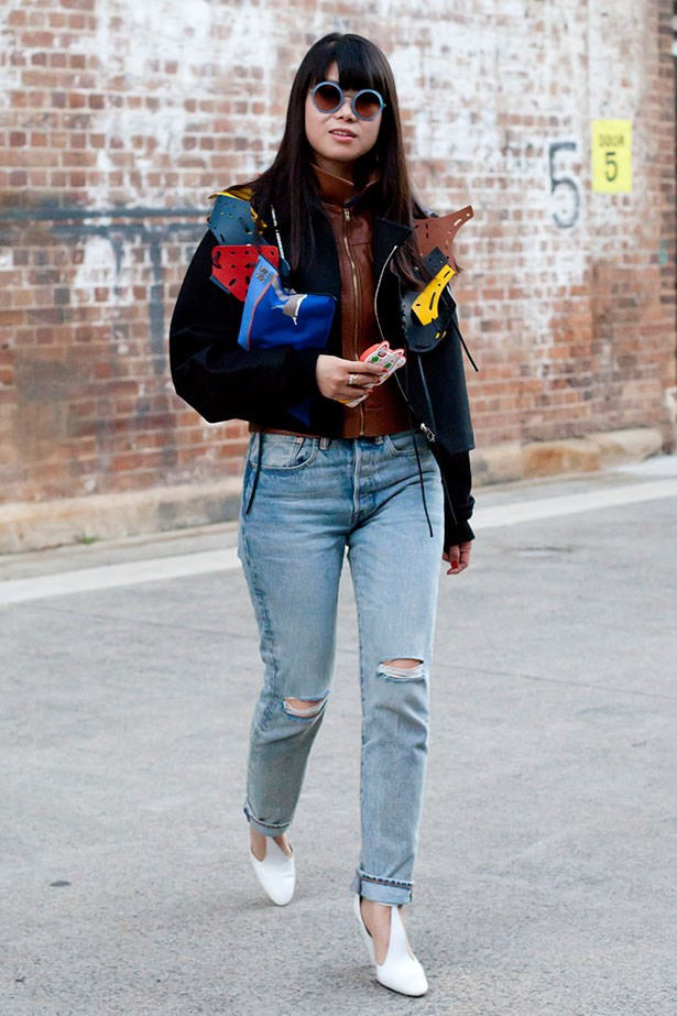 Greener wears a Loewe menswear jacket and clutch, Kate Sylvester top, Am Eyewear sunglasses and Celine shoes at MBFWA this week.