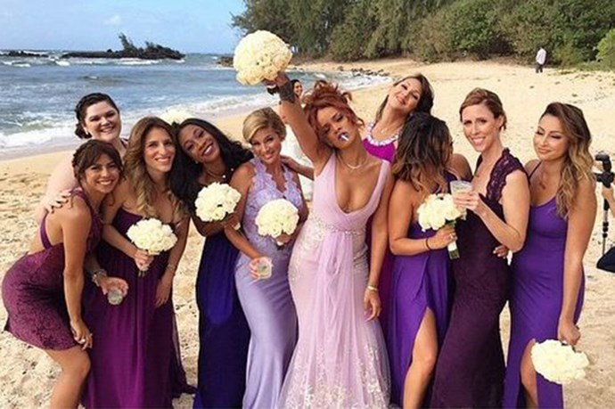 Rihanna did bridesmaid-ing in the most Rihanna way possible by lighting up a joint during the photos.