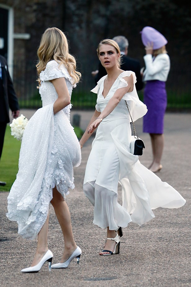 Cara Delevingne was Maid of Honour at big sis Poppy's wedding to James Cook in May of last year, they both wore Chanel.