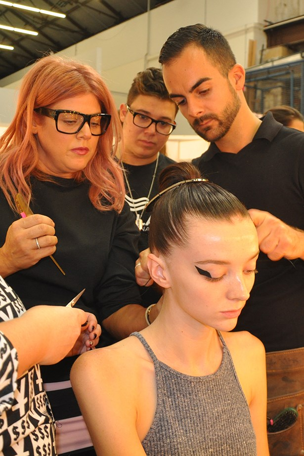 <p><strong>Day 1: Monday </strong></p> <p><em>By Johnny</em></p> <p>My first show for the week is for By Johnny. For each show I demonstrate how to create the hair look to the Wella team then everyone works in pairs to recreate it on their models. Then, each model is brought to me for final touch ups and approval before walking the runway.</p>