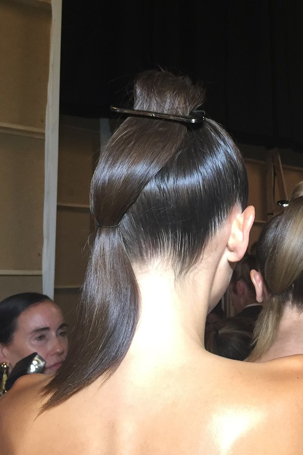 <p><strong>Day 1: Monday </strong></p> <p><em>By Johnny</em></p> <p>The By Johnny woman is elegant with a twist, so I've created a slick sculptural ponytail snaked through a buckle then pinned at the nape of the neck. <p>