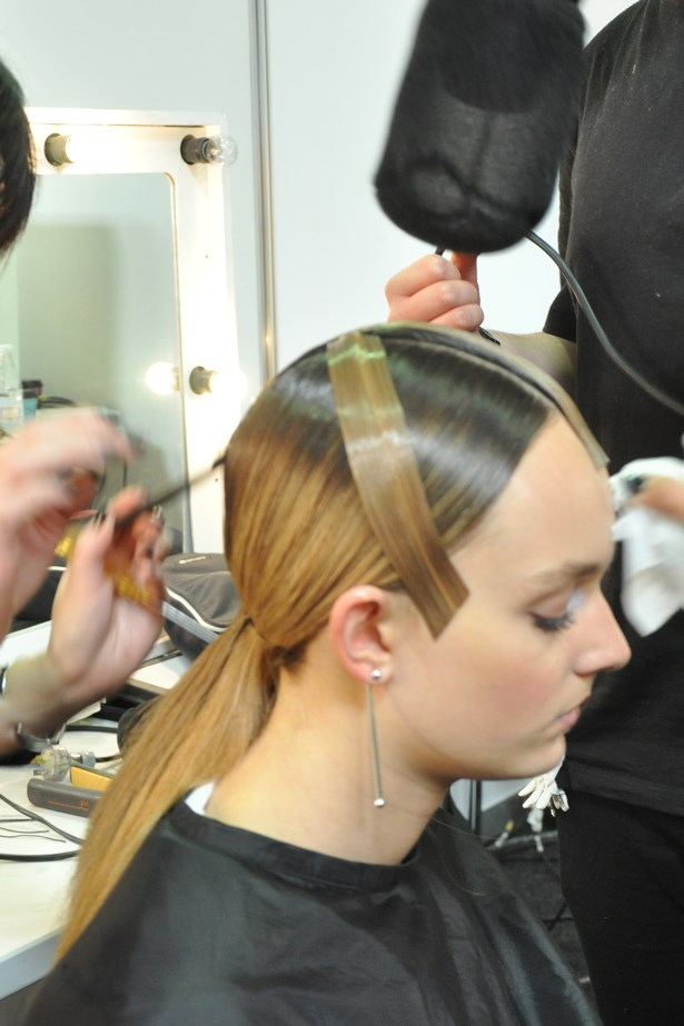 <p><strong>Day 2: Tuesday</strong></p> <p><em>Haryono</em></p> <p>There's a lot going on with the clothes so we pull the hair back into a slick, directional ponytail using Wella Sculpt Force and apply strips of hair extensions to create a panelled fringe and tapered across the crown to the cheekbones.<p>