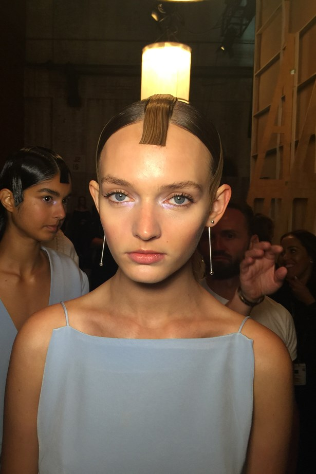 <p><strong>Day 2: Tuesday</strong></p> <p><em>Haryono</em></p> <p>I love this look! It's a structured, origami hair look that compliments Haryono's strong clothes. <p>