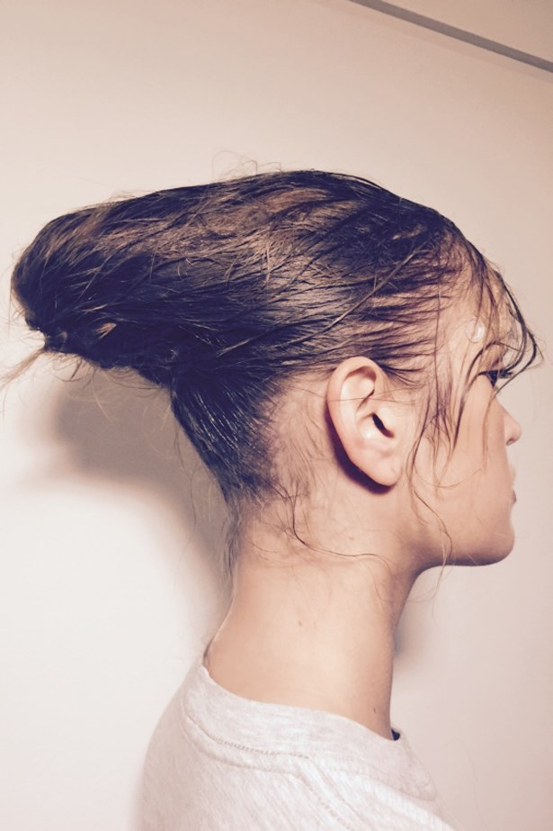 <p><strong>Day 3: Wednesday</strong></p> <p><em>Akira</em></p> <p>Travis has created two different wet-finish hair looks: a ponytail and a bun with dewy flyaways around the hairline. They're ethereal sports-luxe-meets-romantic looks that are reflective of Akira's new and archival pieces. </p>