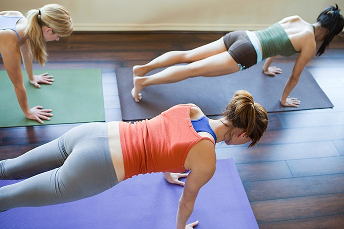 """<p><strong>Do the plank pose</strong></p> <p>""""One of the most effective exercises for developing a tight, toned middle is the plank. It works your transverse abdominal muscle, which wraps around your torso like a belt. By strengthening this, your mid-section will look leaner and tighter, pulling in muffin tops and love handles. You can vary the plank to keep it fun, challenging and incorporating many different muscle groups in more dynamic variations. Best of all, you don't need any tools, you can do it anywhere, it only takes a minute of your day and the results are amazing."""" <p><em>Jess Schuring, personal trainer and founder of the UK's Heartcore gym</em></p>"""