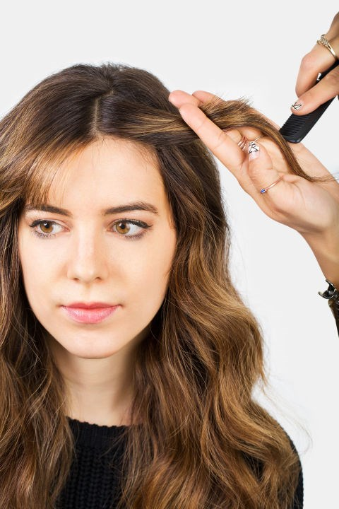 <STRONG>CENTRE PART TWISTS</STRONG> <br><strong>Step 2</STRONG> <br>Gather the fringe and a small section of longer hair behind the fringe line.