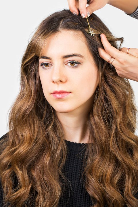 <strong>CENTRE PART TWISTS</strong> <br><strong>Step 4</strong> <br>Leave as is or cover the bobby pins with jewelled pins or clips of choice.