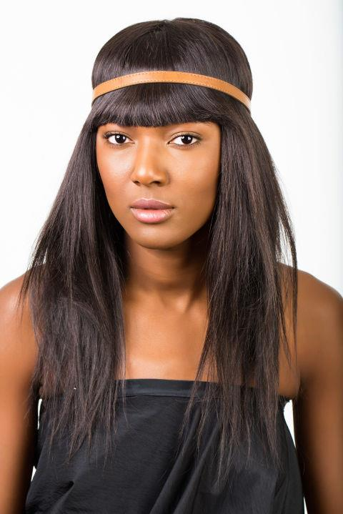<strong>TWISTED HEADBAND </strong> <br><strong>Step 1 </strong> <br>Begin with hair combed smooth. Place headband around the crown of the head, securing the bangs in place.