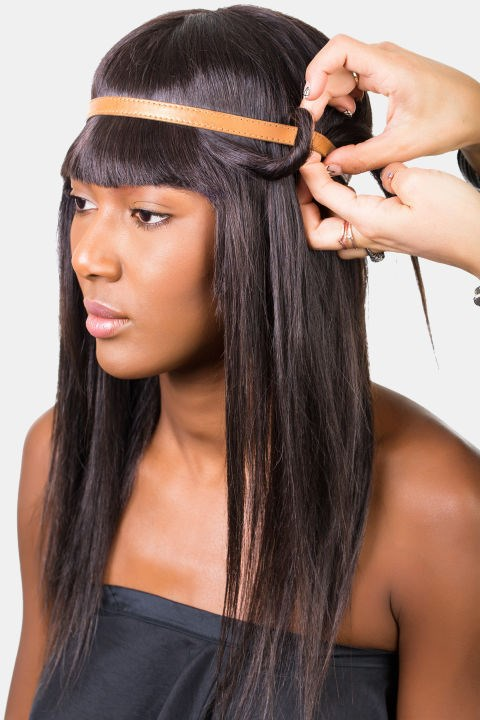 <strong>TWISTED HEADBAND </strong> <br><strong>Step 3 </strong> <br>Carefully loop the hair around the headband.