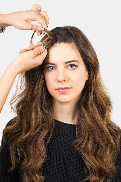 """<strong>MINI FRENCH TWIST </strong> <br><strong>Step 4 </strong> <br>Add a small amount of hair to the section that is hanging closer to your face. Continue to """"cross"""" the two sections and add hair each time."""