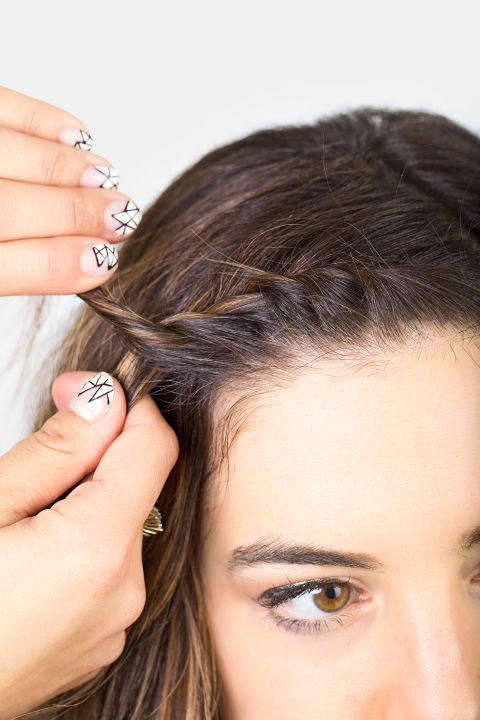 <strong>MINI FRENCH TWIST </strong> <br><strong>Step 6 </strong> <br>Continue until you're about halfway back on your head. Tuck the new hair in a little less tightly as you get towards the end.