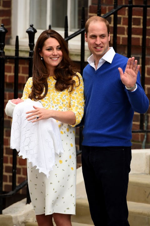 Kate showcases her new baby princess wearing a yellow and white Jenny Packham dress.