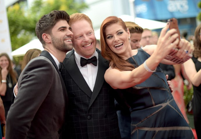 <strong>JUSTIN MIKITA, JESSE TYLER FERGUSON, AND DEBRA MESSING</strong>