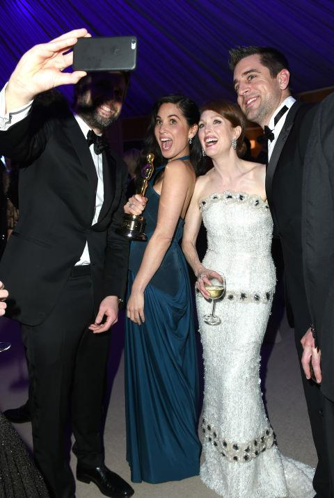 <strong>BART FREUNDLICH, OLIVIA MUNN, JULIANNE MOORE, AND AARON RODGERS</strong>