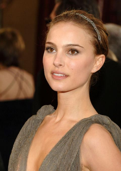 """2005<br> At the Academy Awards: Portman recalls her stylist, Kate Young, improvising a last-minute headband: """"It's actually a bracelet, and she was like, 'Put it in your hair!' It was pretty and subtle and just a fun way to wear jewellery ."""""""