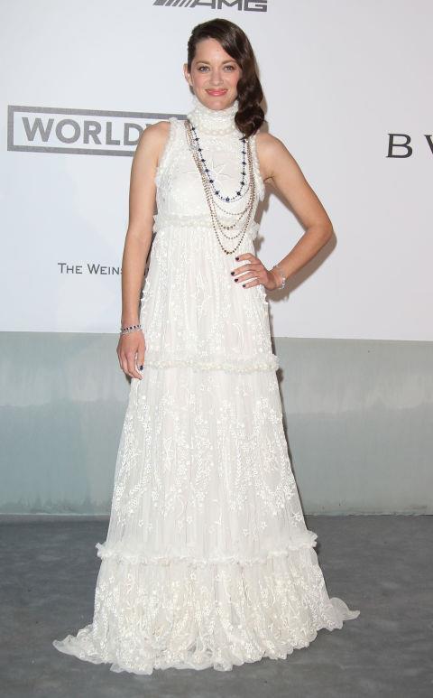 <strong>MARION COTILLARD</strong> <BR> Wearing Alexander McQueen in 2014.
