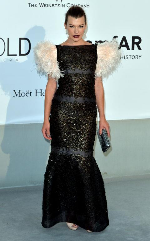 <strong>MILLA JOVOVICH</strong> <BR> Wearing Chanel Couture in 2014.