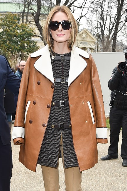 """<strong>The Statement Piece</strong><br> This season, channel that 70s vibe with one on-point piece. Whether you opt for tan leather or a camel trench, it's all about a boxy silhouette and finishing touches—like being double breasted and having a two-toned collar—that will have everyone asking: """"where did you get your coat?"""".<br><br> <i>Image: Olivia Palermo</i>"""