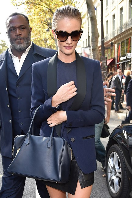 """<strong>The Navy Blazer</strong><br> Navy is having a <em>major</em> moment, so make it yours with a tailored blazer. No matter what your office dress code, this is the one to wear from boardroom to bar and beyond. Don't be afraid to mix it with black staples—the old rule of """"no navy and black"""" is long gone this season. Hurrah! <br><br> <i>Image: Rosie Huntington-Whiteley</i>"""