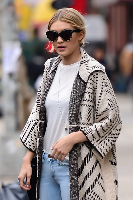 <strong>The Blanket Wrap</strong><br> Enter the of-the-moment coat: the blanket wrap. Think of it, <em>literally</em>, as a blanket with sleeves (cozy, huh?!) that's your go-to boho cover-up. Worn over frayed denim for a hippie look or adding an element of downtown cool over a little black dress, this one is going to be <em>everywhere</em>. <i>Image: Gigi Hadid</i>