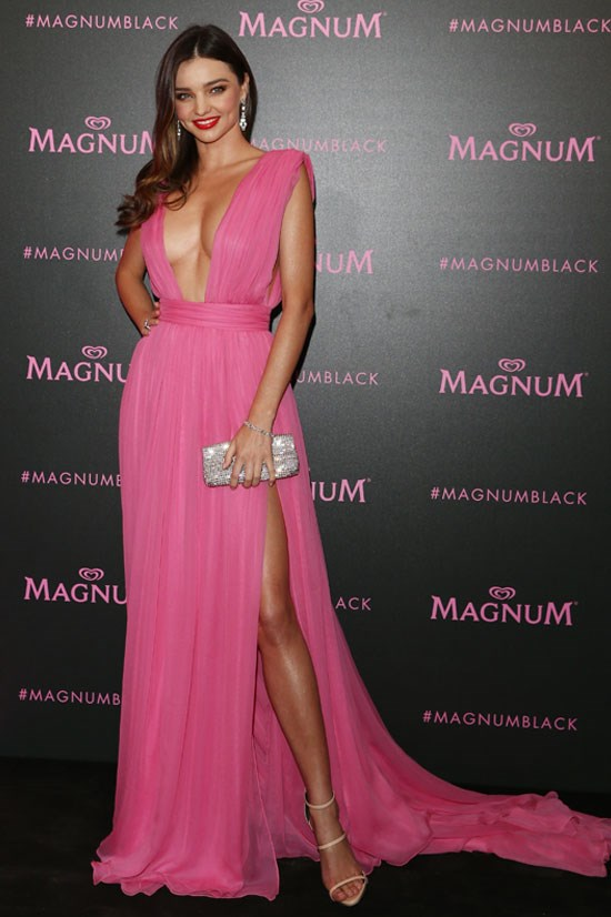 <strong>Miranda Kerr</strong> wearing Emanuel Ungaro with Oroton clutch.