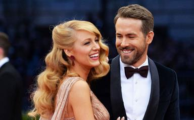 Here's Ryan Reynolds holding hands with his baby