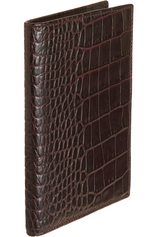 "<a href=""http://www.barneys.com/smythson-mara-croc-stamped-passport-cover-500461957.html#start=61 "">Passport cover</a>, $210, Smythson, Barneys.com"