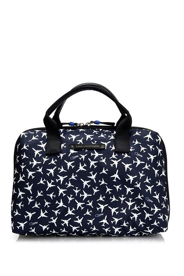 "<a href=""http://www.matchesfashion.com/au/products/Diane-Von-Furstenberg-Voyage-large-cosmetics-bag-1009440#"">Cosmetics bag</a>, $116, Dian Von Furstenberg, matchesfashion.com"