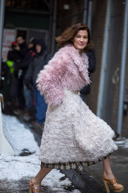 """This ombré-pink shaggy coat looks incredible teamed with brown plaid and platforms. Her lip colour is also thoughtfully matched."""