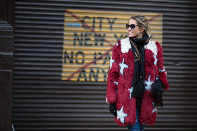 """Despite the chill factor, this girl looks like she's having a great time. The mix of textures and the star pattern in her coat is so fun- no wonder she's smiling."""