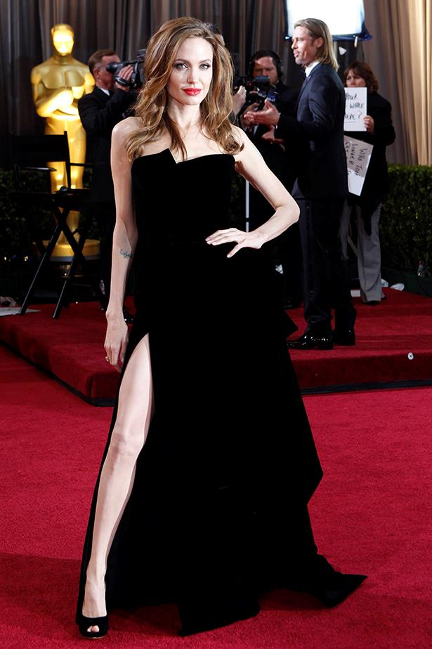 That dress. That leg. Atelier Versace at its vampiest.