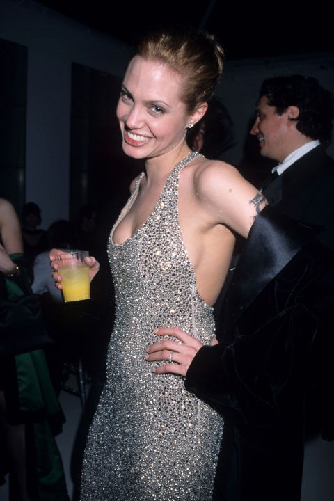 At the 1999 Golden Globes, with sideboob and cocktail.